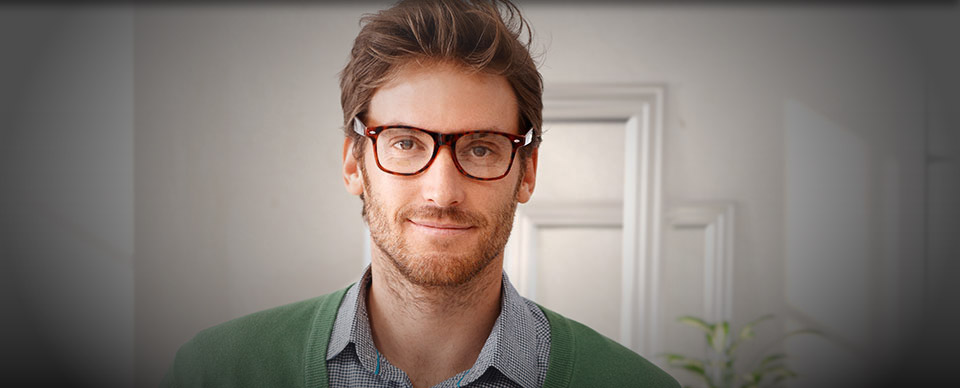 Man smiling with glasses